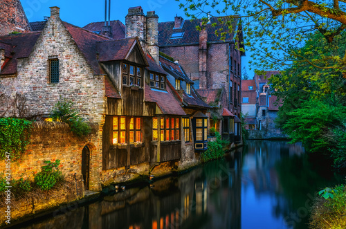 Medieval houses over canal in Bruges Belgium evening landscape