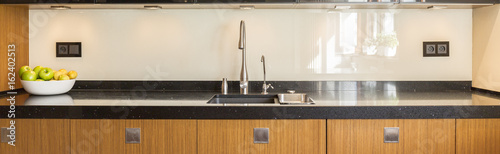 Fototapeta Kitchen with wooden furniture