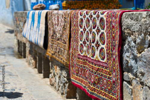 Poster Marokko carpets drying after laundry in chefchaouen, morocco