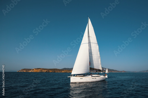 Luxury yacht boat at Regatta. Sailing in the wind through the waves at the Sea.