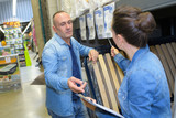 couple shopping parquet in hardware store shop for construction - 162450168