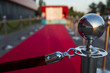 Quadro Long red carpet between rope barriers on VIP entrance.