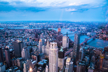 Aerial view of downtown Manhattan and Financial District at dusk.