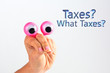 Funny character creature looking surprised and amused depicted with female hand and googly eyes with text Taxes? What Taxes? Tax avoidance concept