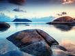 Sea shore with large stones at sunset. Beautiful tropical landscape