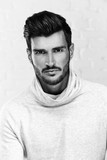Black and white portrait photo of handsome man