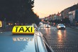 Taxi car on the city street - 162511172