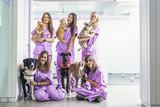Cheerful women team veterinary holding her pets. - 162532367