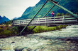 Tourist relaxing on bridge in village Oppstryn Norway