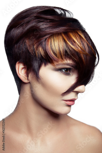 Fashion portrait of a beautiful girl with colored dyed hair, professional short hair coloring. isolated on white background. studio shot..