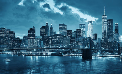 New York City skyline at night, color toning applied, USA.