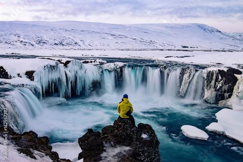 Adventurous man at Godafoss, Iceland in winter - 162557702