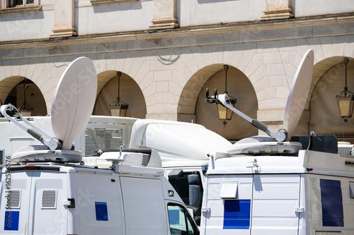 In de dag Milan Milan, Italy - June, 19, 2017: vans with TV equipment near La Scala opera theatre in Milan, Italy