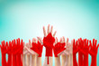 Canada flag pattern pf people's hand raising up on blue sky for national holiday celebration and voting rights