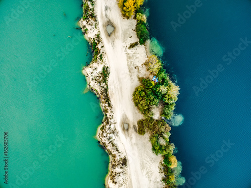 Foto op Canvas Groen blauw Aerial view - narrow strip of sandy shore and green and blue water