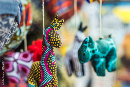 funny colorful handmade fabric toys at african market Poster