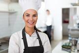 Female chef in kitchen  - 162609186