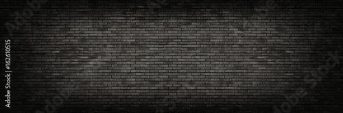 Fototapeta Black brick wall panoramic background.