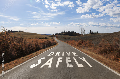 Plakat Concept drive safely message on the sunny summer asphalt country road
