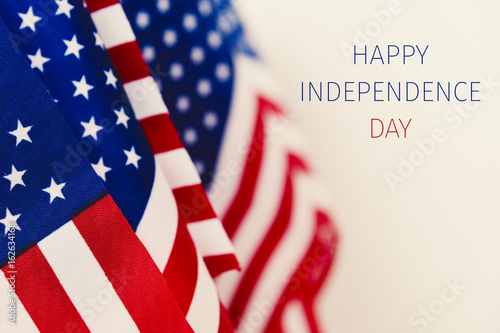 Poster text happy independence day and american flags
