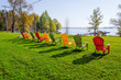 Row of lawn chairs on a green grass background in summer time. Ontario, Canada