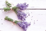 Bunches of fresh purple lavender on white wood