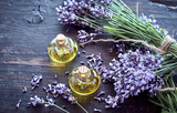 Fresh lavender with essential oil on rustic wood - 162638720