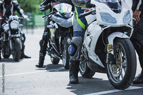 Fotobehang Fiets Motorcycle luxury items close-up: headlights, shock absorber, wheel, wing, toning.