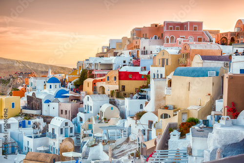 view of Oia, traditional greek village of Santorini, with wonderful sunset.