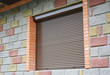Shutter security barrier. Window with rolling shutter for house protection. Security Shutters Grilles.