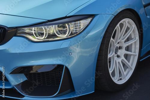Clean California car; blue performance machine with white wheels
