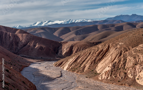 View of High Atlas mountains with dry river bed, Gorges de Dades, Morocco