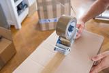 House Moving Concept. Closeup of Man Packing Boxes - 162716372