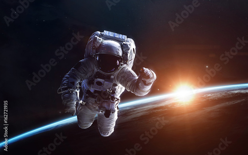 Foto op Canvas Nasa Astronaut above the Earth. Science fiction space wallpaper, incredibly beautiful planets, galaxies, dark and cold beauty of endless universe. Elements of this image furnished by NASA