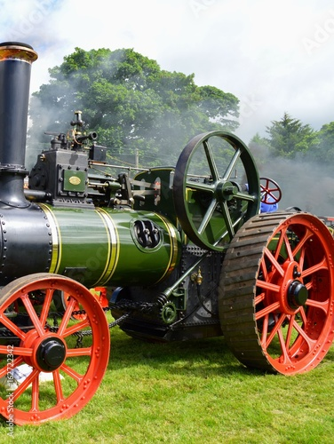 A green steam engine belching smoke at a rally at Castle Fraser Aberdeenshire in Scotland