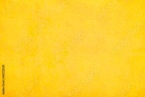 Texture and background of yellow concrete wall..