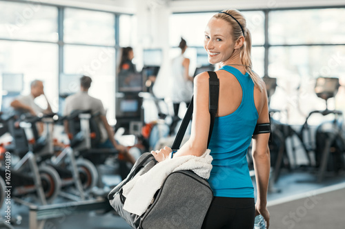 Wall mural Woman with gym bag