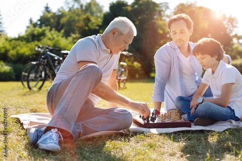 Intelligent inspiring family playing chess