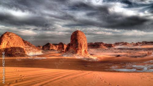 Poster Panorama of El-Agabat valley in White desert at sunset, Sahara, Egypt