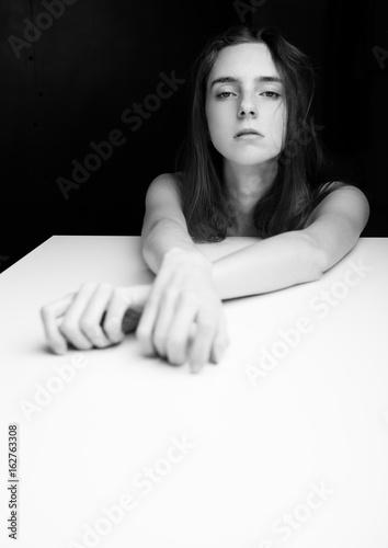 Beautiful girl with elegant hands on white cube © DenisMArt
