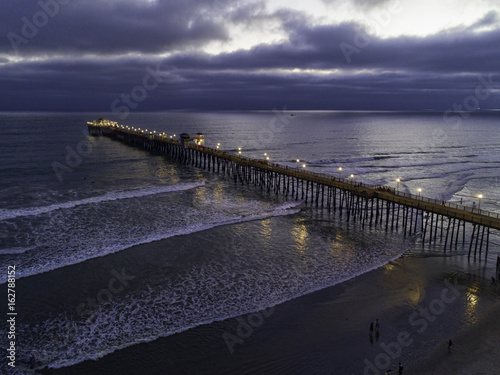 Dramatic aerial capture of the Oceanside Pier just after to sunset. Oceanside is 35 miles North of San Diego, California, USA