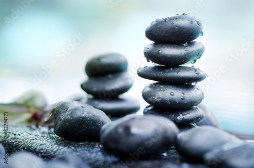 Heap of spa stones with water drop still life style