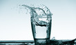 Quadro Water splash in glass. Drinking water concept
