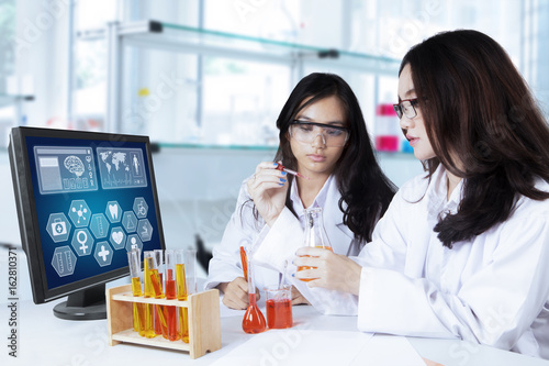 Two pretty scientists doing experiment