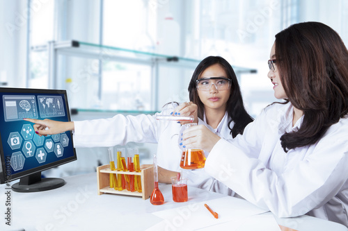 Two students doing chemical research