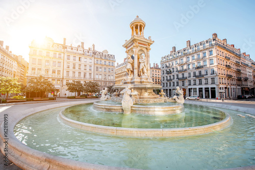 Morning view on Jacobins square and beautiful fountain in Lyon city, France Poster
