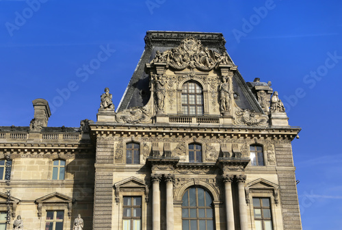 Facade of the royal Louvre palace Poster