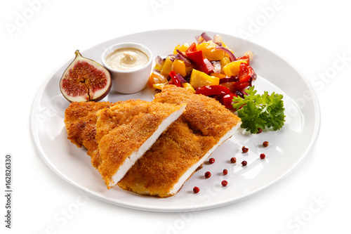 Fried pork chop coat in breadcrumbs and vegetable salad  - 162826330
