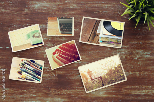 Poster top view of photos collage on wooden background