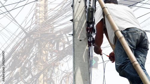 Thai Technician working at electricity pole